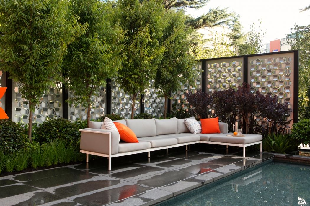 Outer art co decorative facades rusted metal screens for Screening walls for gardens