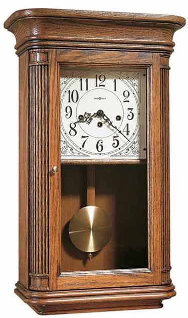 <p> A flared, molded bonnet and fully molded base. The off-white dial features Arabic numerals and floral-patterned corner accents. A spun brass pendulum bob appears behind the front-opening glass door which features a polished brass door pull. Finished in Oak Yorkshire on select hardwoods and veneers. German Key wound, Westminster chime movement with chime silence lever and...