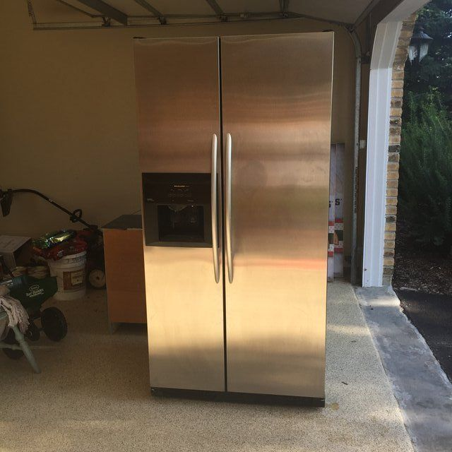 Used counter-depth side by side refrigerator/freezer in