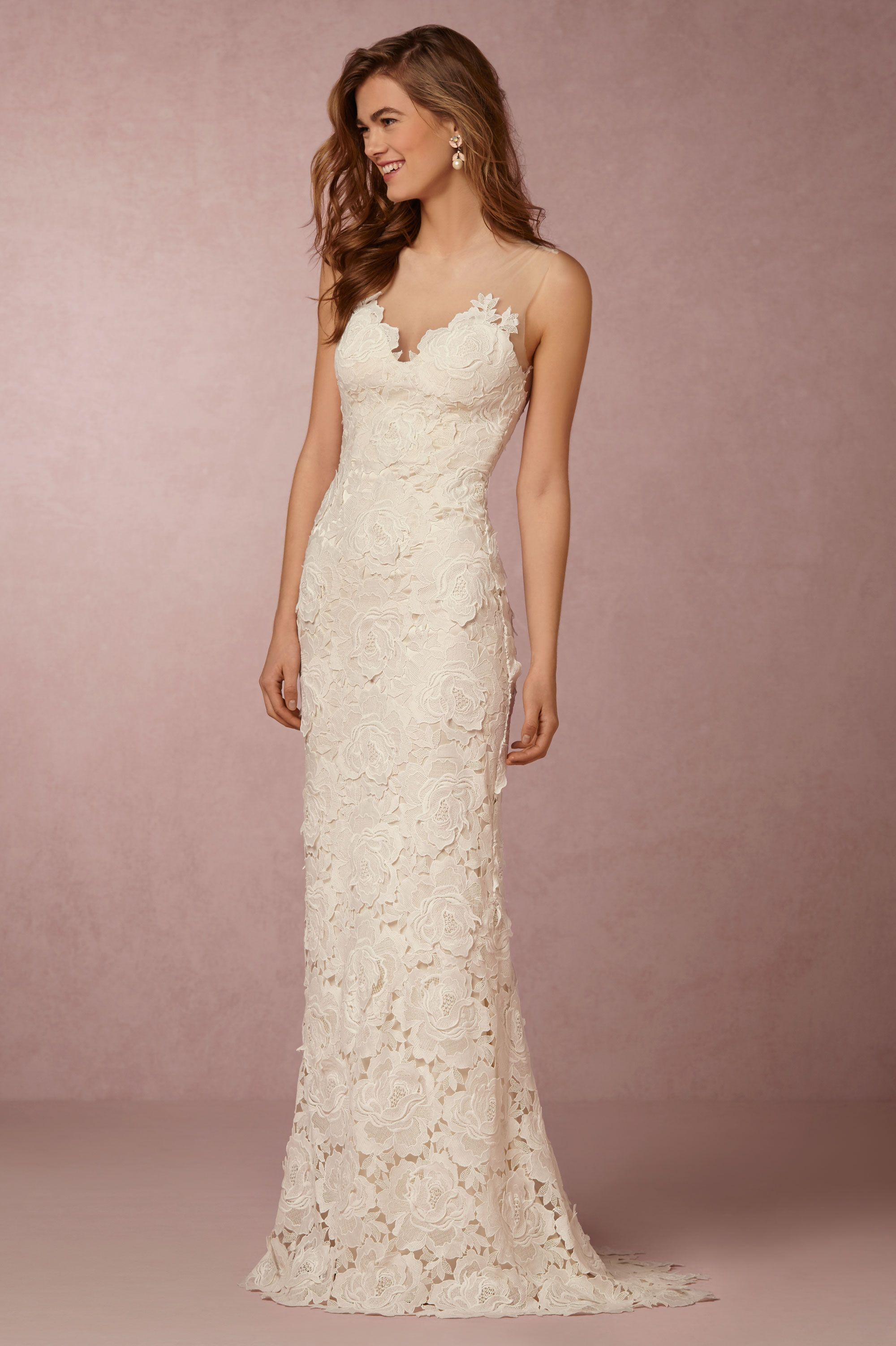 Lace wedding dress with a bold floral motif. The figure