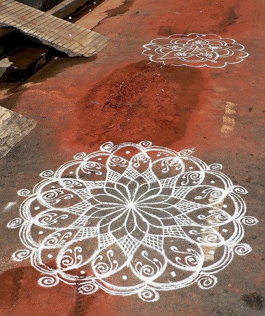 I know it's supposed to be allowed to wash away, but I'd be hard pressed not to paint this permenantly on my driveway, maybe a little off center... Geometry on the Pavement by premasagar, via Flickr
