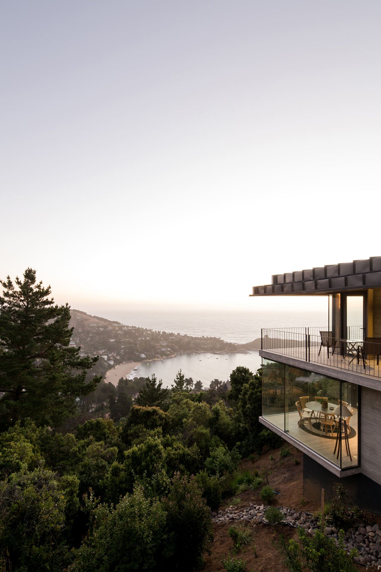 An Isolated Hillside House In The Forest Overlooking Zapallar Bay