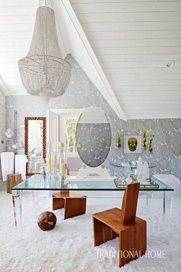 An extravagant crystal chandelier adds a layer of once to this ... on designer dining room, designer show homes, designer lamps, designer rugs, designer charlotte moss, designer chairs, designer bunny williams, designer paint colors, designer fabric, designer bathroom, designer flowers,