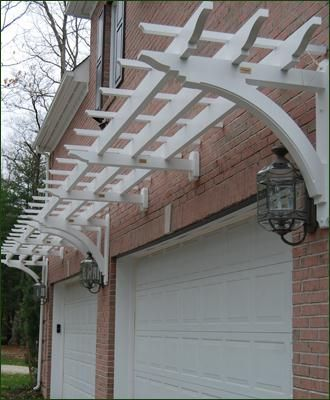 Trellis above garage door. A great way to dress up the garage.