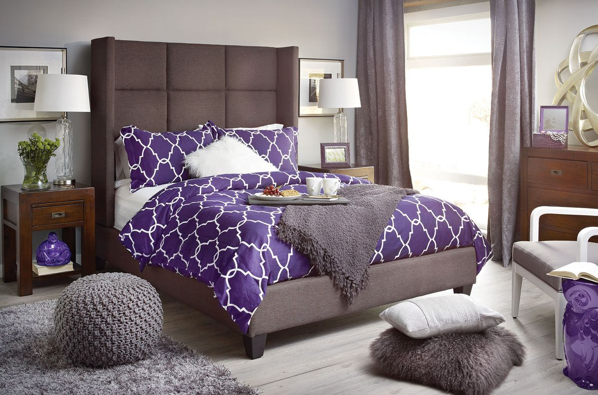 Purple people sleeper. A sanctuary from the holidaze.  Featured: Custom Greyson Queen Bed - Polo Grey, Post and Rail Nightstand, Post and Rail Low Dresser, Uber Shag Rug - Charcoal, Marina Pouf - Charcoal, Lattice Queen Bedding Set - Purple