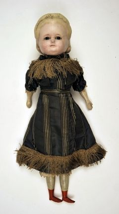 "1880 Doll Medium: wood, wax, composition ""Pumpkin"" head doll, with fair moulded hair, brown inset eyes. Made of thin wax over composition with wooden limbs and rag body. She is wearing a grey striped silk dress with lace at elbows and fringing at neck and hem over petticoat, chemise and drawers. She is also wearing orange painted boots."