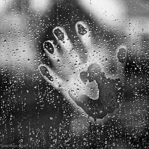 hand on wet window black and white rain window hand wet one life