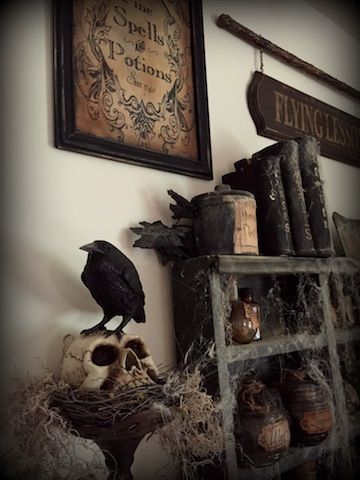 crow sitting on skull on top of nest - Halloween Crow Decorations