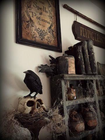 crow sitting on skull on top of nest