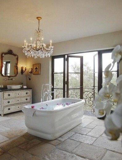 Crystal chandelier over vintage style cast iron bathtub with vintage style floor mount tub filler. Description from pinterest.com. I searched for this on bing.com/images