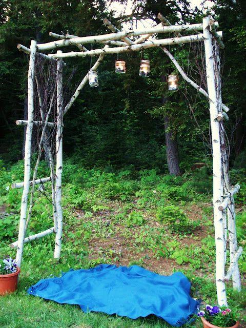 A Garden Arbor And Mason Jar Lanterns With Images Mason Jar