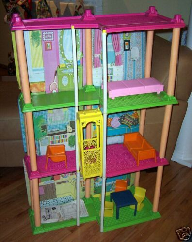 We had this Barbie Townhouse growing up. I think we still have most ...