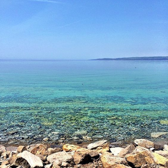 Caribbean waters? Nope, it's #PureMichigan! As today marks the first official day of summer, we had to share this beautiful capture by @laurenstarmer from the shores of #BayHarbor. Thanks for sharing!