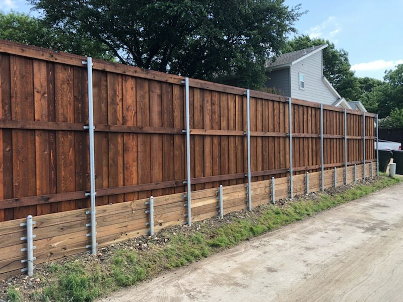 Pre Sealed Cedar Board On Board Fence With Trim Cap Treated Retaining Wall And Metal Posts Installed By Titan Fence Retaining Wall Backyard Cedar Boards