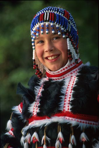 Alutiq Native girl dressed traditional Kodiak Alaska beaded headdress | ©Alaska Stock Images