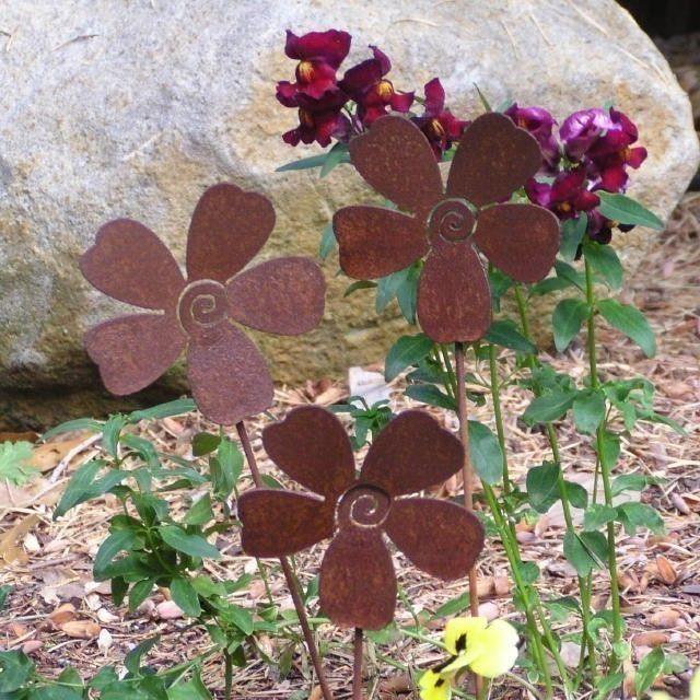3 Rusty Metal Flowers Garden Art Yard Stake Set. $21.99, Via Etsy.