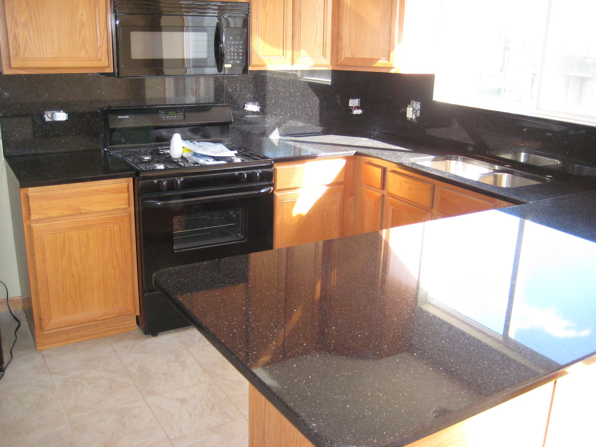Granite Black Galaxy with full height backsplashes done on ... on Backsplash For Black Granite  id=44239