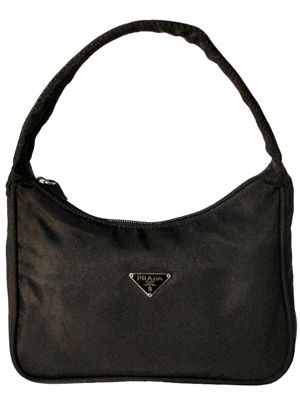 a12b3d854e4b When Miuccia Prada introduced black nylon handbags to the market in 1985,  they became an instant status symbol. (I still have mine - in fact I wore  it a few ...