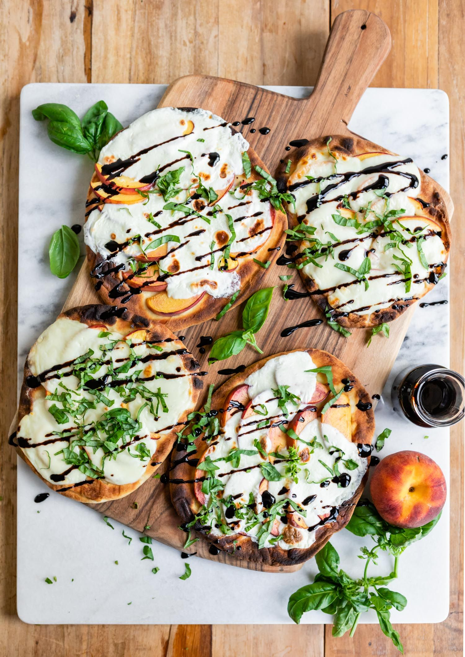 This Grilled Peach Caprese Naan Pizza Is the Ultimate Easy Summer Meal | Hello Veggie