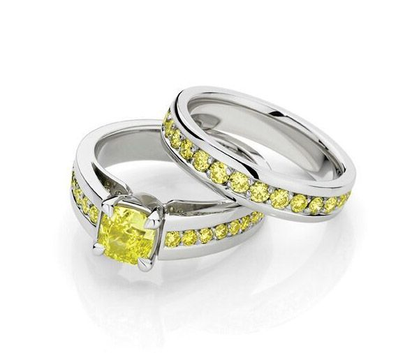 a1b75658f31 18ct white gold diamond engagement ring features a natural yellow diamond,  in a four claw