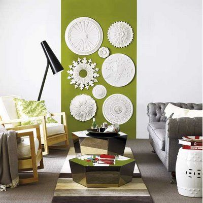 Love this collection of ceiling medallions used as wall decor.