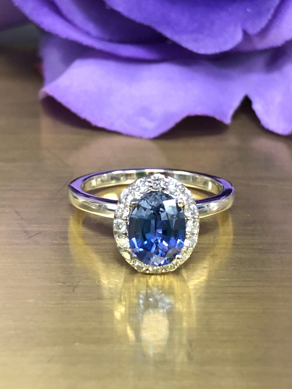 Oval Ceylon Blue Sapphire With Round Genuine Diamond Halo