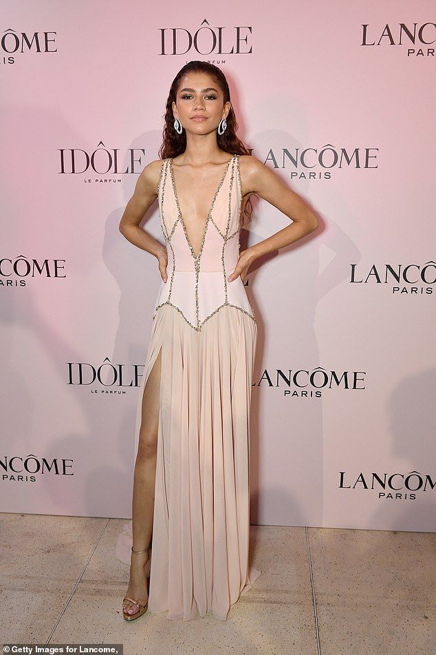 Zendaya turns heads in a plunging blush gown with a thigh