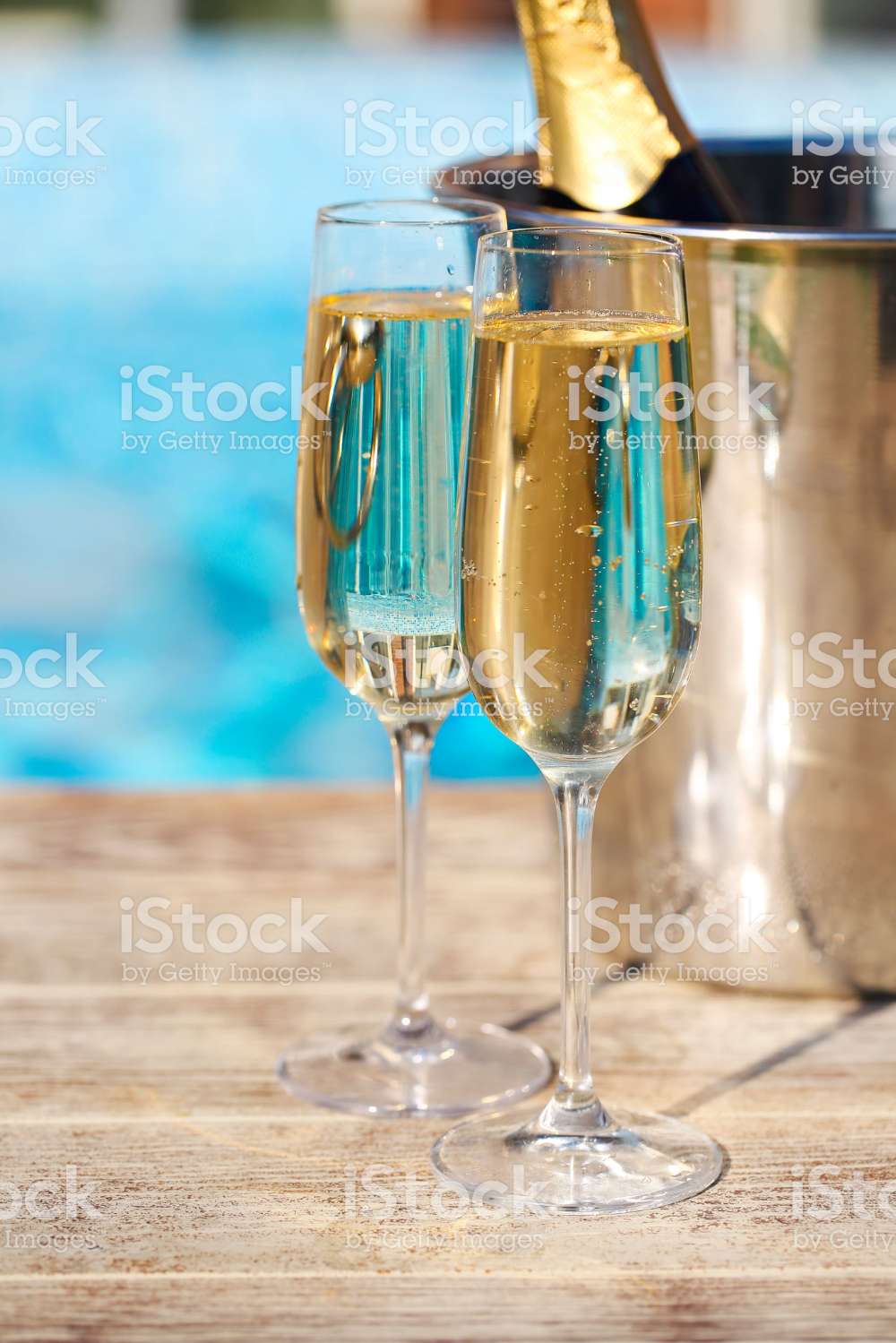 Champagne Glasses And Bottle In Ice Bucket Near Swimming Pool Champagne Glasses Champagne Bottle
