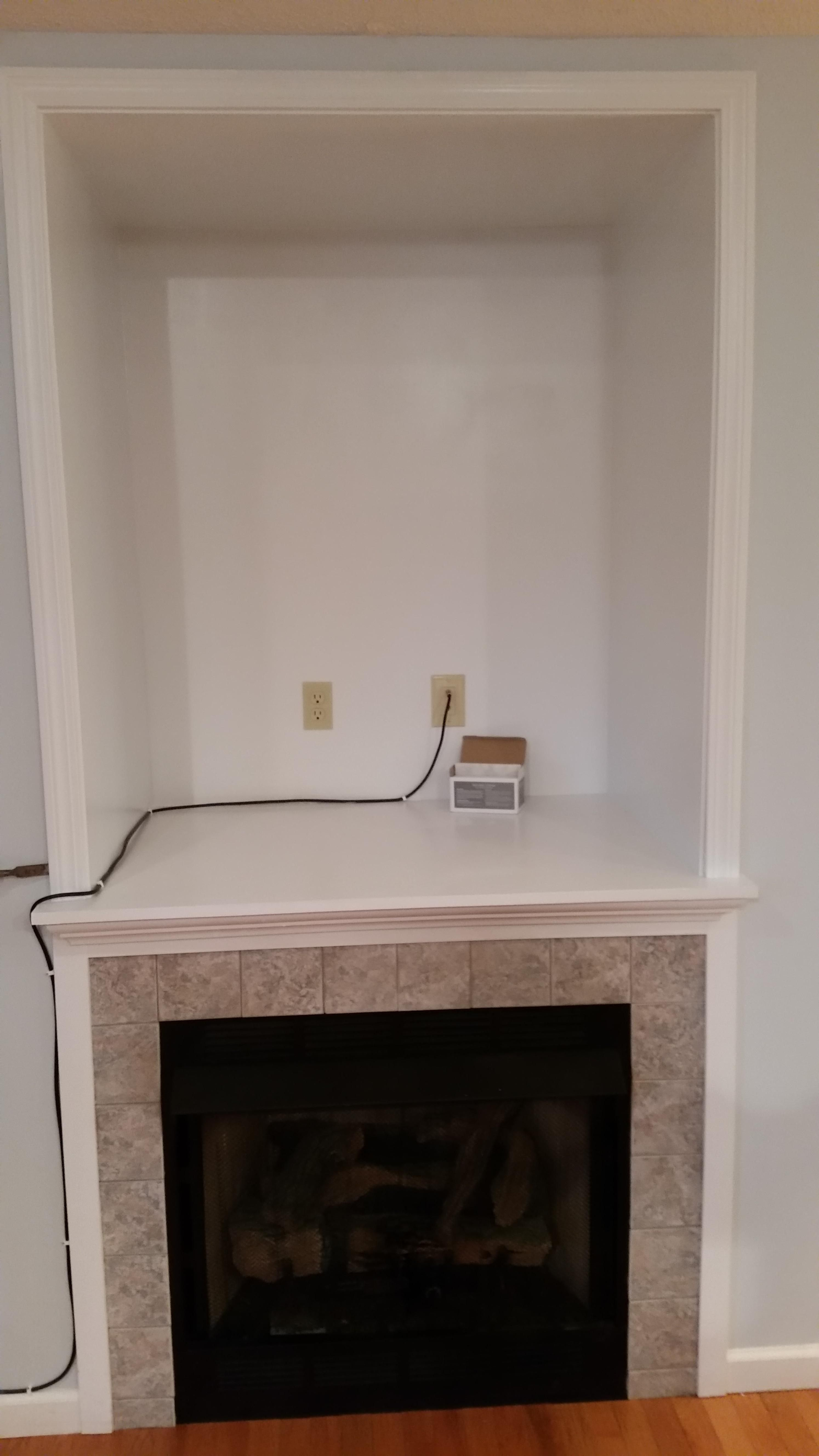 I turned a old tV nook into a fireplace mantel with a