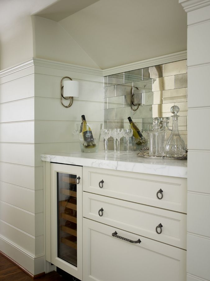 Kitchen Bar Boasts Tongue And Groove Paneled Alcove Filled With Antiqued Mirrored Subway Tile Backsplash Over Ivory Cabinets Oil Rubbed Bronze Ring