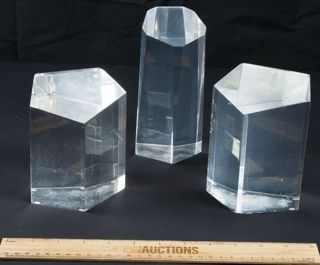 THREE LUCITE BOOKENDS SHAPED IN A OCTAGON SHAPE THAT MEASURES ABOUT 5 IN TALL.