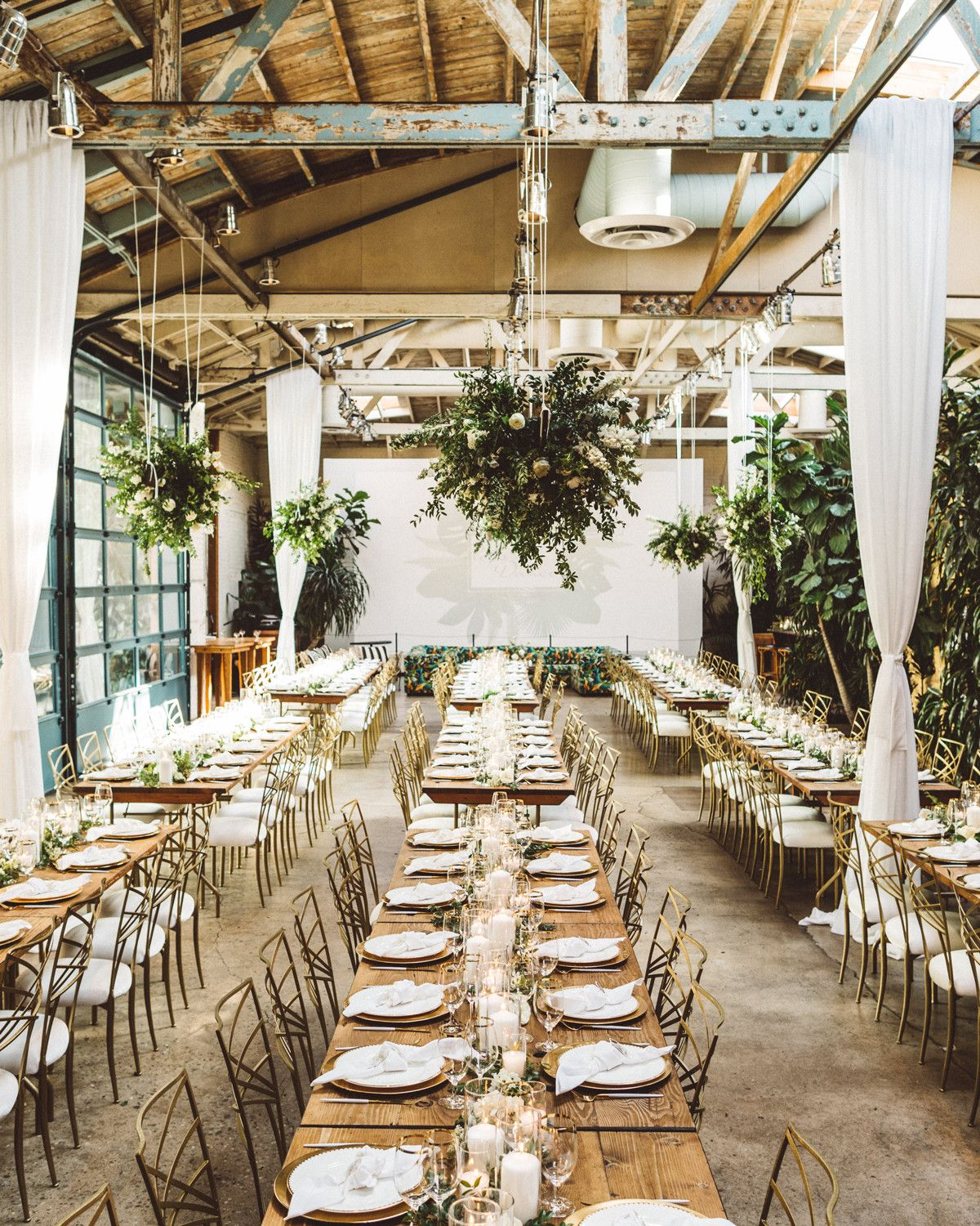 Lush Greenery Transformed A Downtown Los Angeles Warehouse Into This Couple S Ultimate Wedding Venue Warehouse Wedding Whimsical Wedding Theme Whimsical Wedding