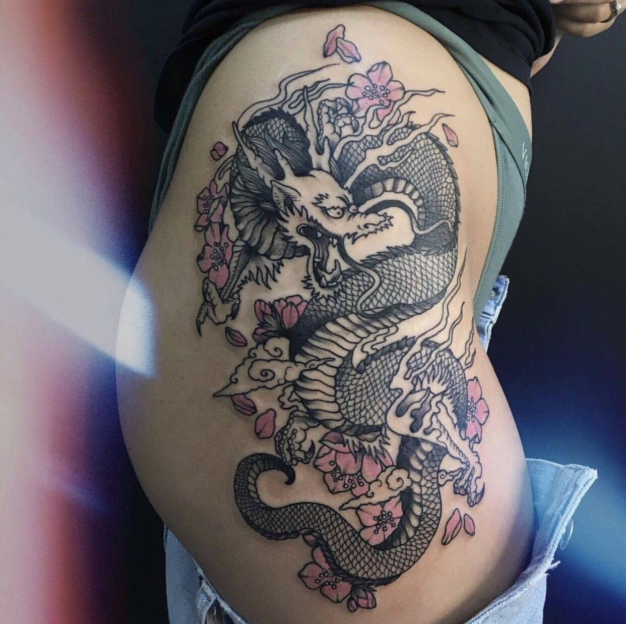 Japanese Dragon Tattoo With Pink Colored Sakuras And Clouds On The Hip Side Hip Tattoo Dragon Thigh Tattoo