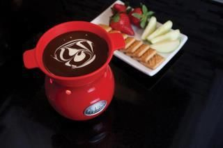 This is a Fondue Warmer that keeps the Belgium Chocolates warm the whole time you entertain. Coming May 1st.