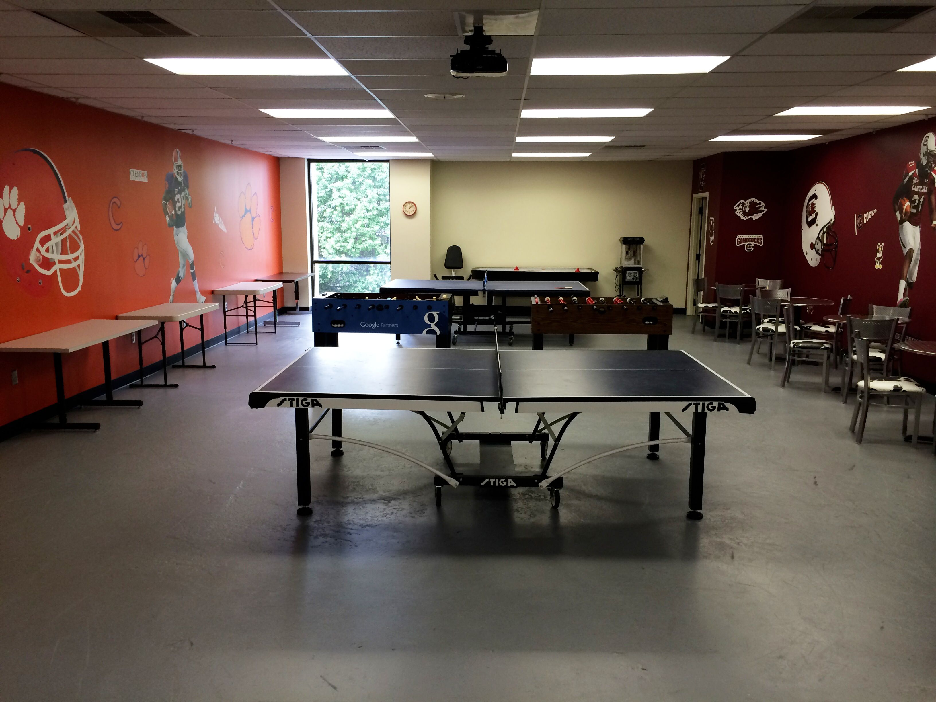 The upstairs game room! USC vs. Clemson  Heated ping-pong matches and more!