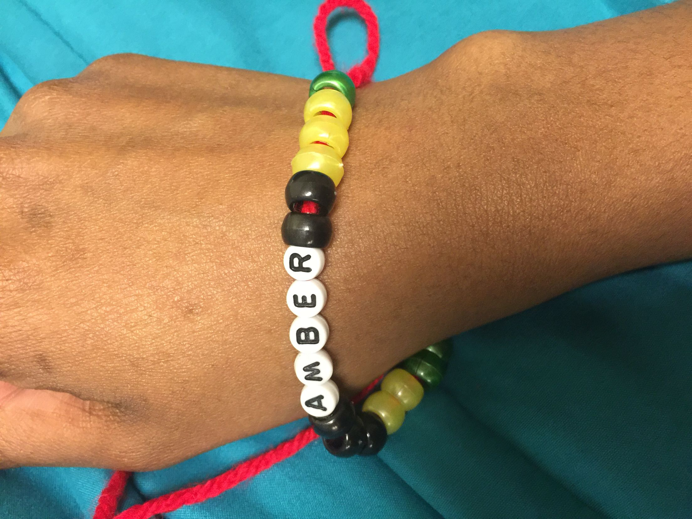 Jamaican friendship bracelet craft..  - I had my client follow the directions to making a friendship bracelet. This week we are learning about the country Jamaica.