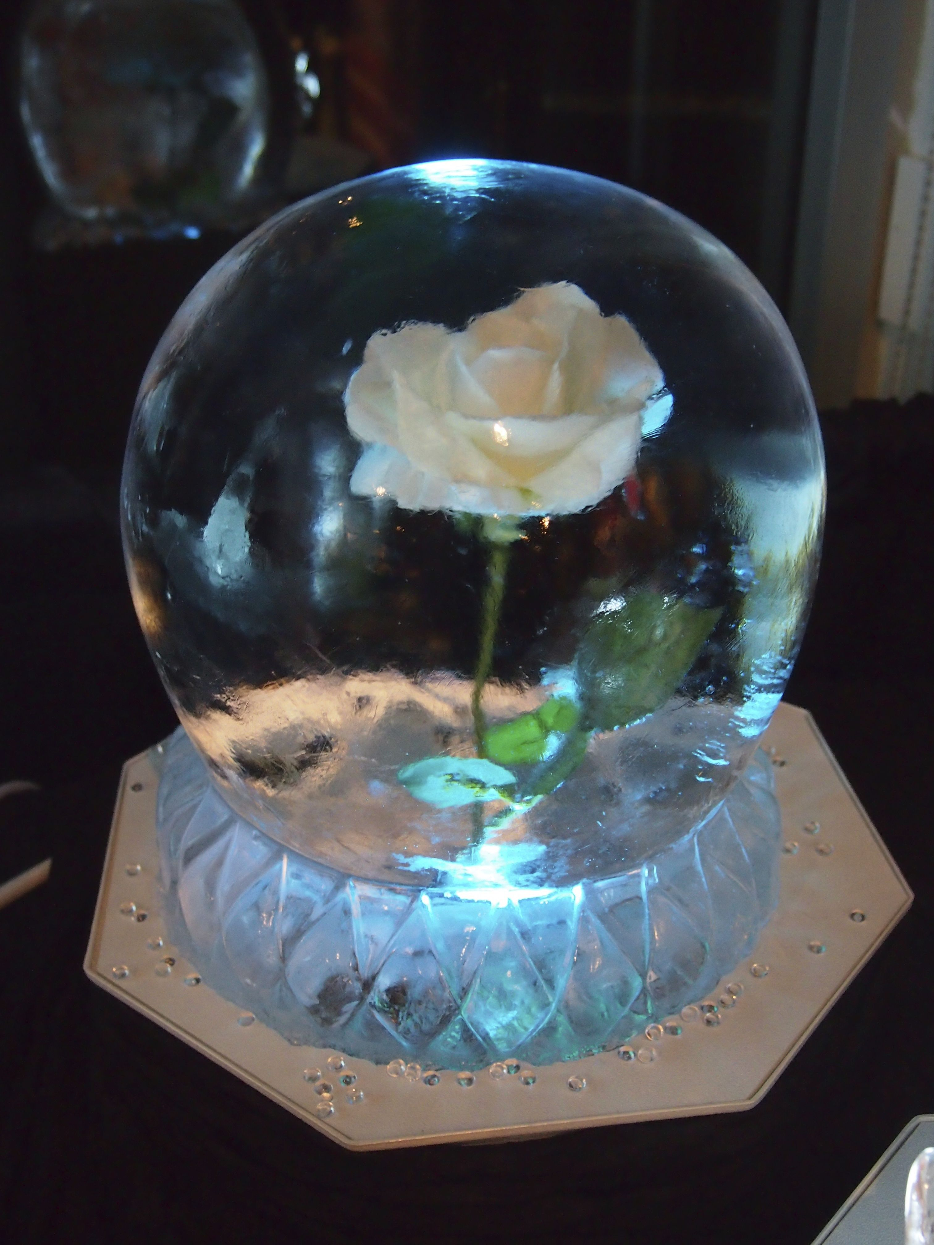 Wedding table centerpiece ice sculpture globe with a