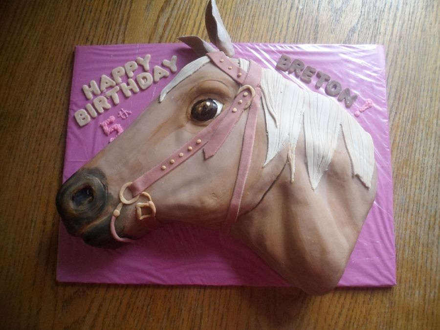 Simple Horse Cake horse head shaped cake into a horse head and