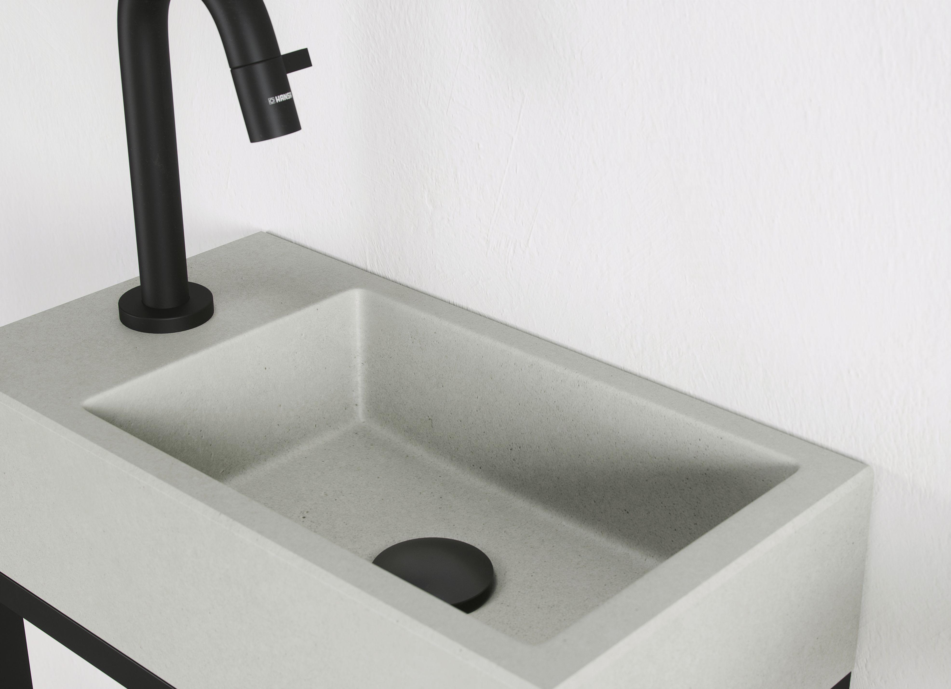 Een rauw en stoer toilet met deze wastafel van robuust beton zorg