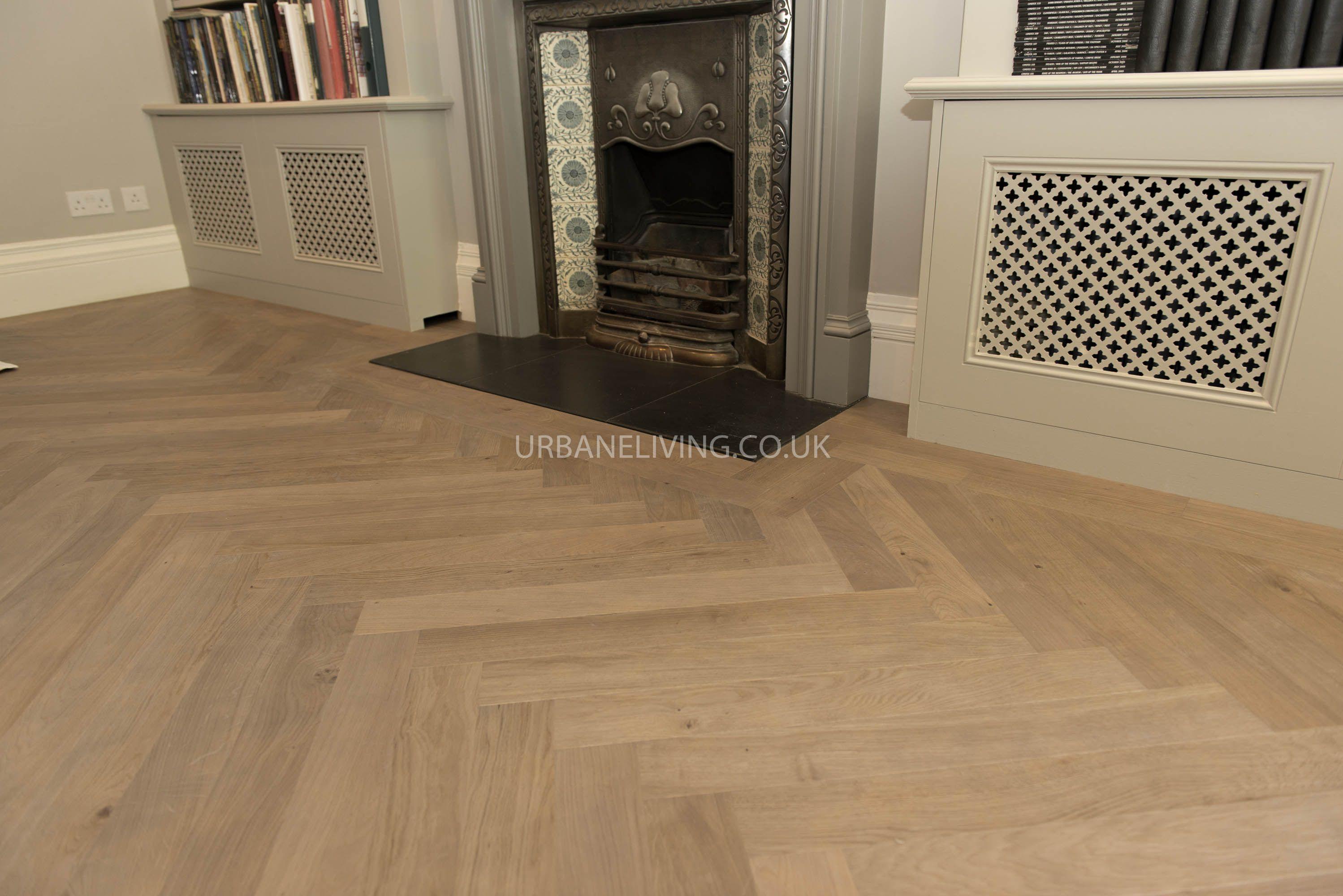 Herringbone wood flooring with 2 line border around fire