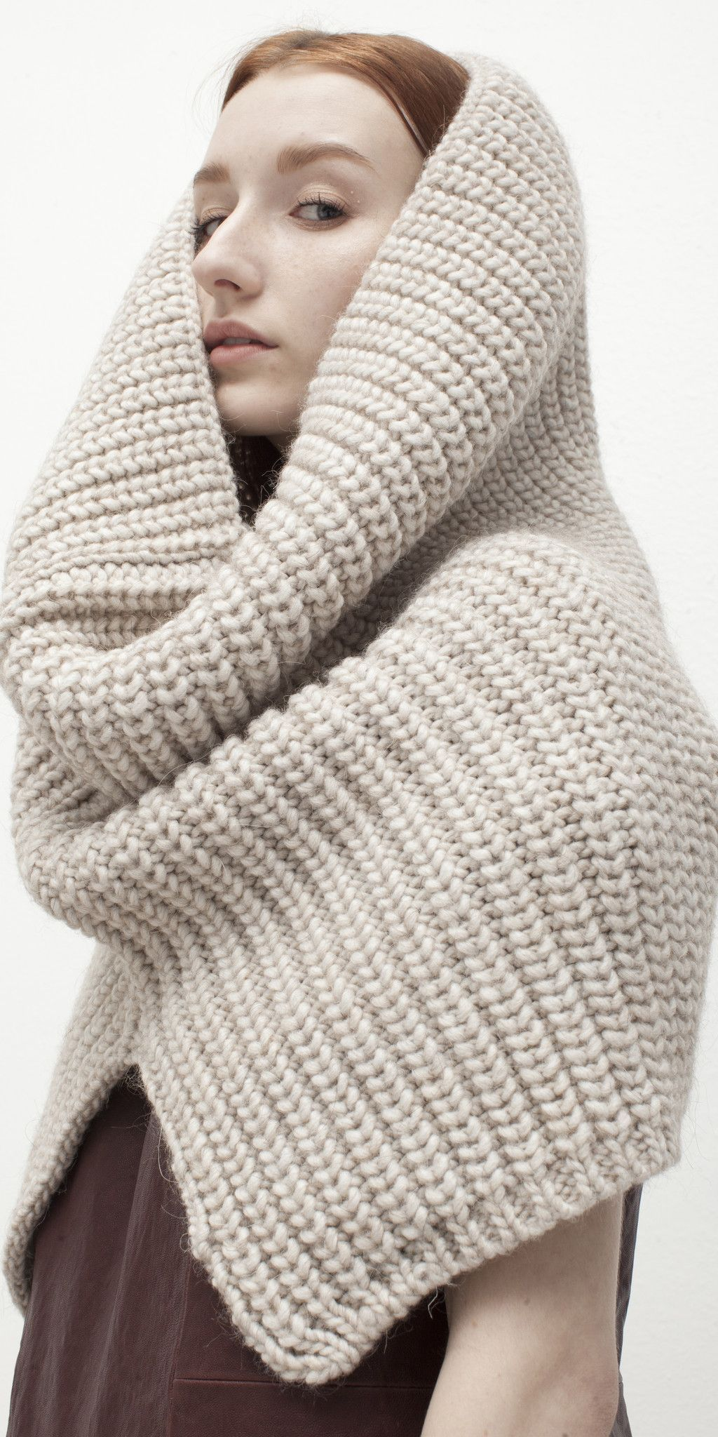 Heavy-gauge knit blended from Italian alpaca yarns composes a ...