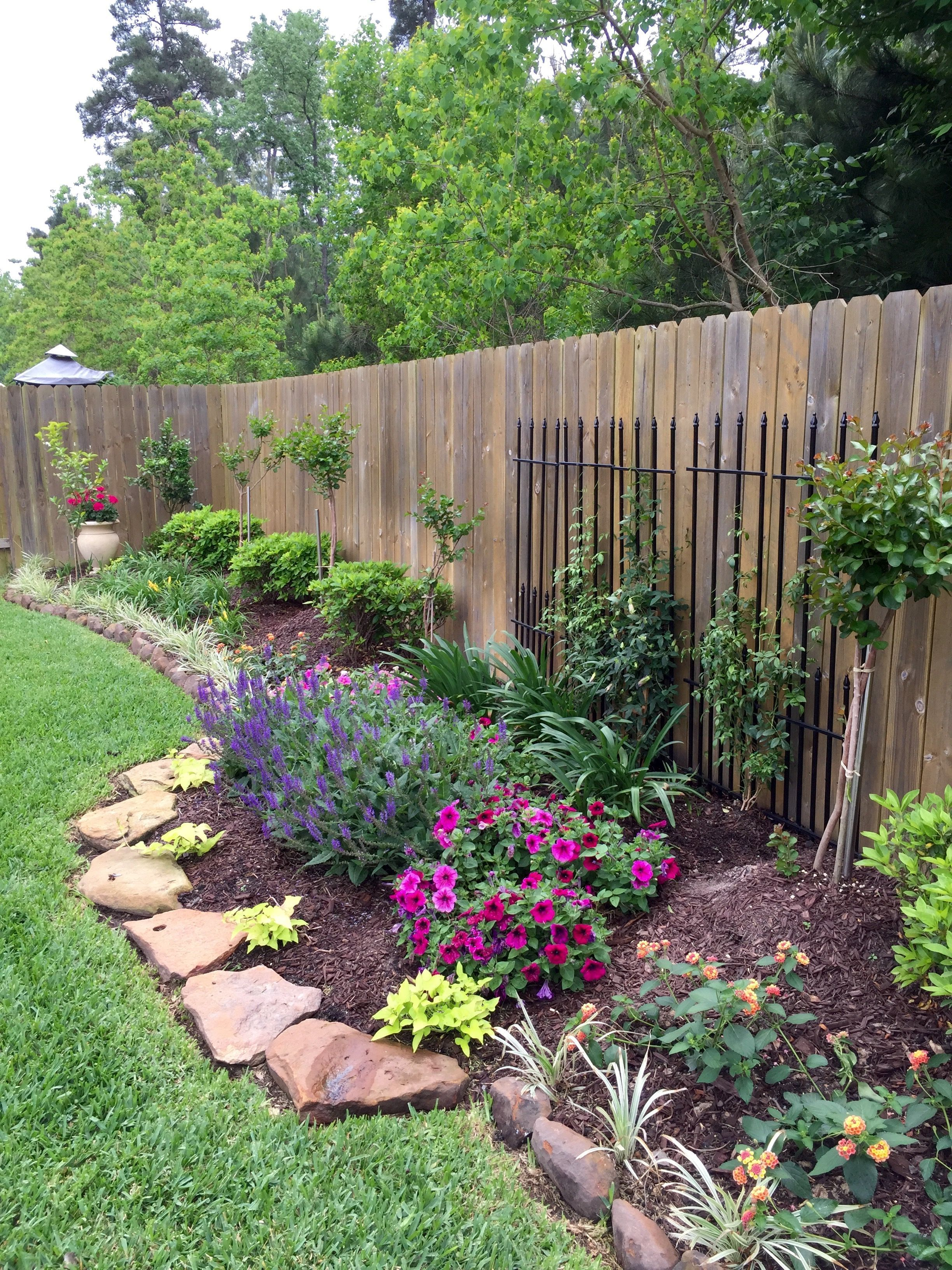 This is a nice way to use black fencing from an old house against a stockade fence at the neighbors side to Improve the look
