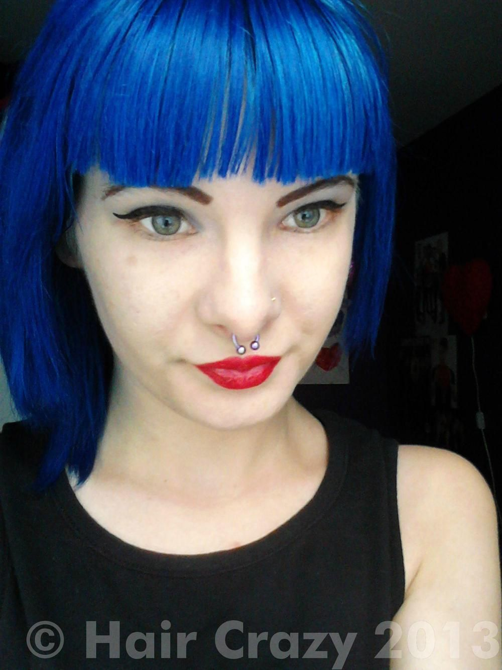 Midnight blue is a rich deep blue hair colour in ambient light itus
