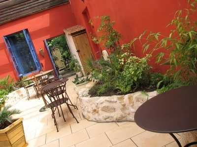 Vivid Walls With Complementary Blue Wooden Doors Make A Warm Mexican Patio  Inviting And Lively In Any Weather