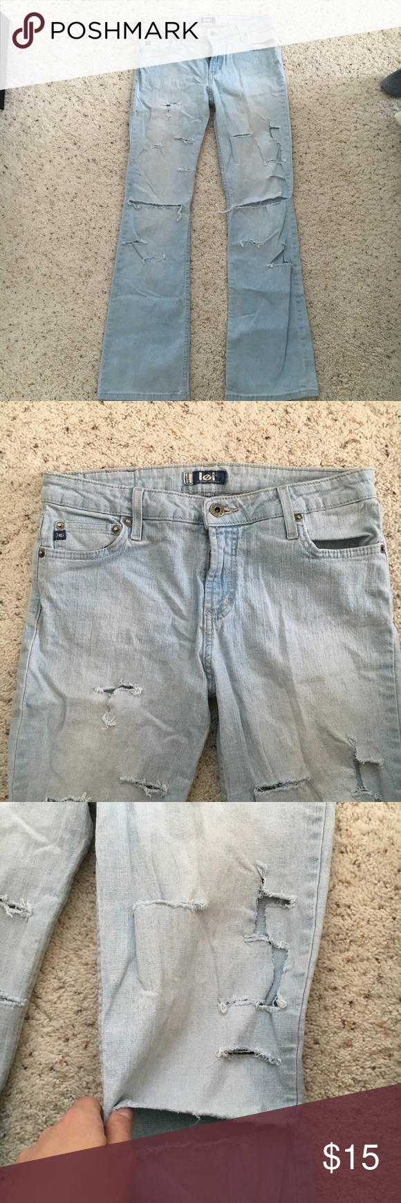 Lei Jeans Ripped Destroyed Light wash flare Pair of low rise l.e.i. Jeans in a super light wash. Flare, low rise, quite a bit of stretch. It true to size. Large rips on the knees and other fashion rips all over. Distressing and rips only on the front of the jeans. Worn a fair amount, I grew out of them so there is life left in these! L.e.i.. Jeans Flare & Wide Leg