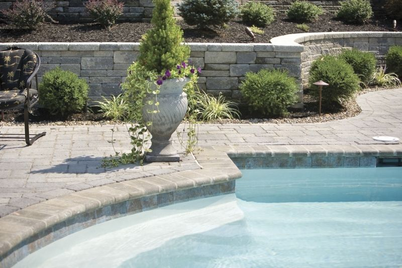 The Landscaping Around The Swimming Pool The Retaining Wall And The Landscape Lighting Are Part