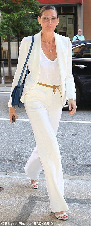 Gigi Hadid and Lily Collins flash flesh in skin-baring outfits in NYC #whiteslacks All white: Tory Burch wore a  white dress with contrasting panels at the waist and sleeves whileJenna Lyons chose white slacks with a white blazer and a white scoop-necked tee #whiteslacks Gigi Hadid and Lily Collins flash flesh in skin-baring outfits in NYC #whiteslacks All white: Tory Burch wore a  white dress with contrasting panels at the waist and sleeves whileJenna Lyons chose white slacks with a white b #whiteslacks