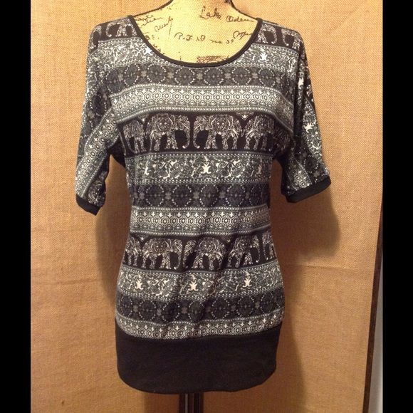 Rue 21 top Rue 21 top size large. It is black and white. Elephant print. It has black lace at the top in back. Good condition Rue 21 Tops