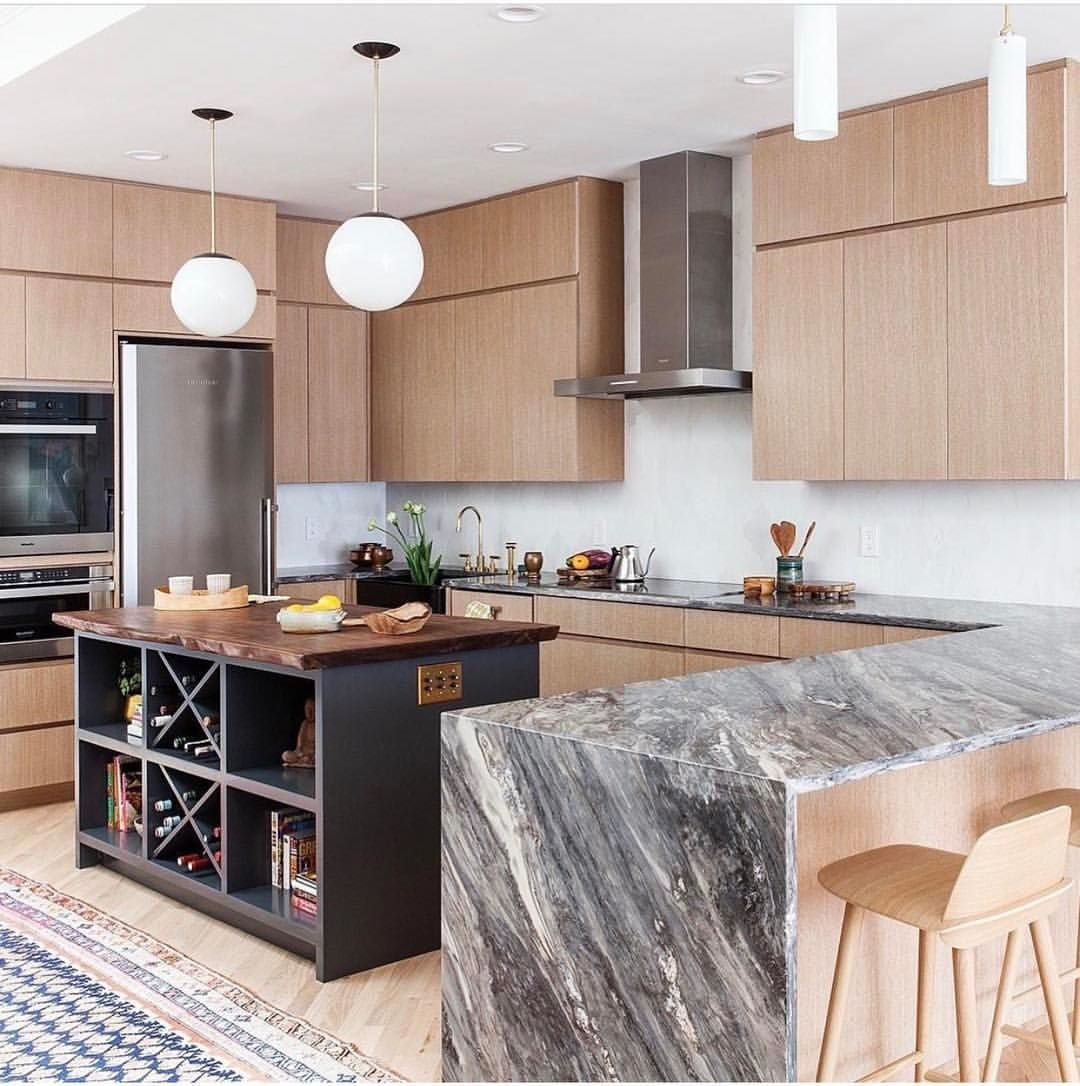 How about a non white kitchen with a stunning waterfall countertop! Love this design from @indigochre @audramanzano