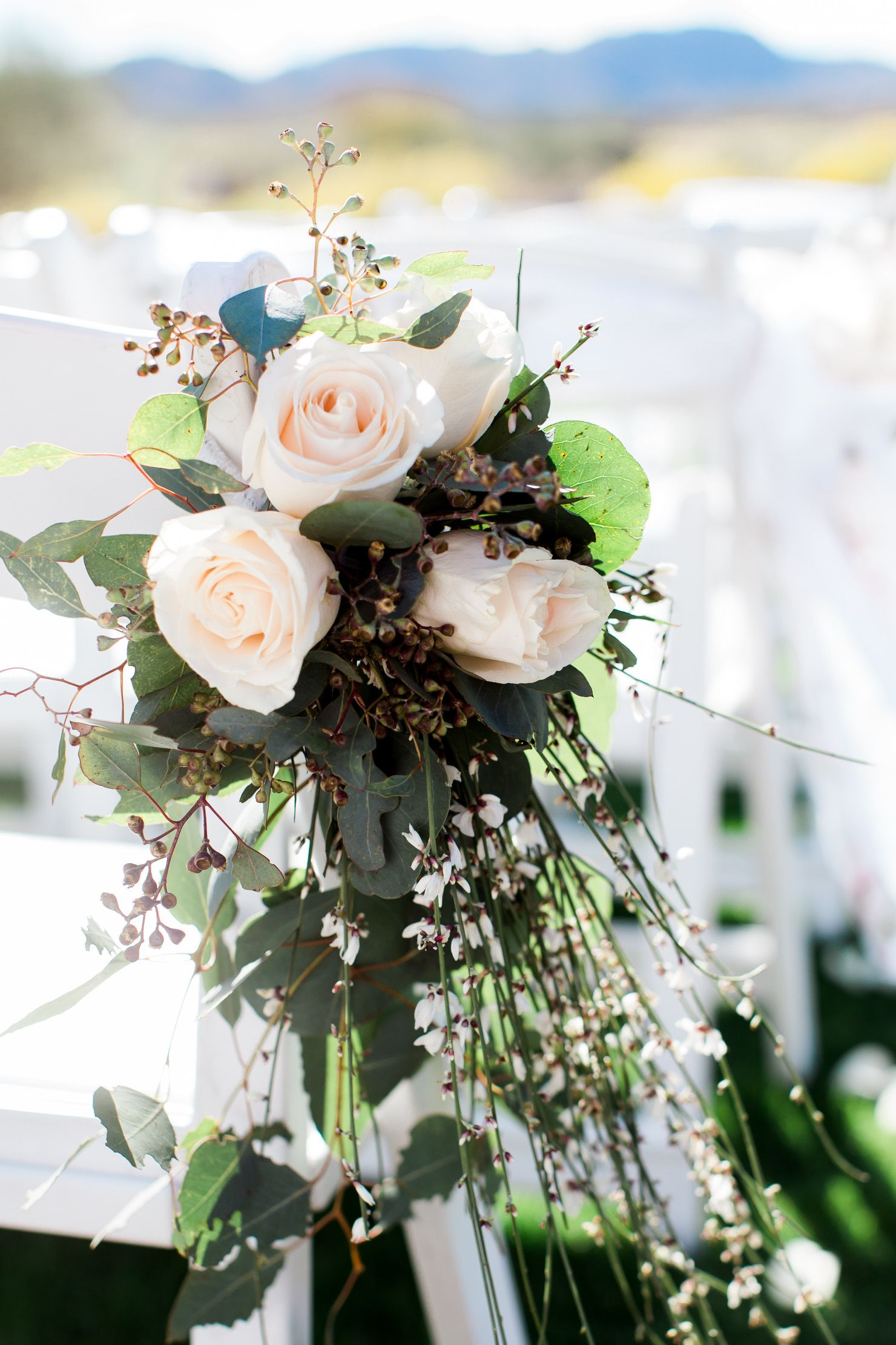 Beautiful cream roses with eucalyptus and white Genista in